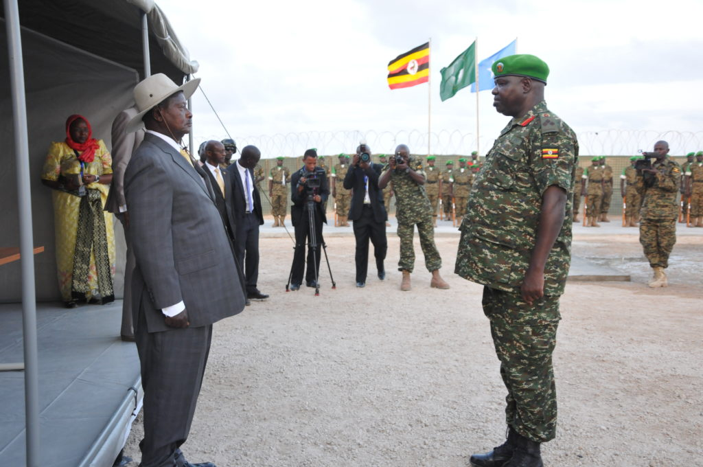 President Yoweri Museveni talks to one of the UPDF commanders