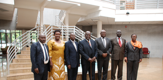 Backbench Commissioner with the Speaker Parliament of Zambia (third right) and Clerk of the Assembly (extreme right)