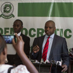 Democratic Party Spokesperson, Kenneth Paul Kakande (R) address the media at the head quarters during the party's press conference on April 21, 2015. PHOTO BY ISAAC KASAMANI