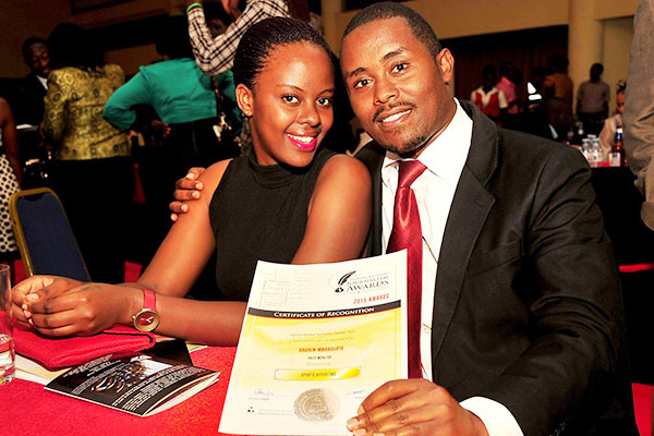 Monitor sports reporter Andrew Mwanguhya (L) poses for a picture with a friend.