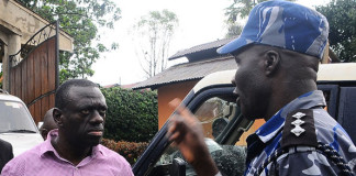 Senior Superitendant of Police Sam Omala confronts Dr Kizza during walk to work.