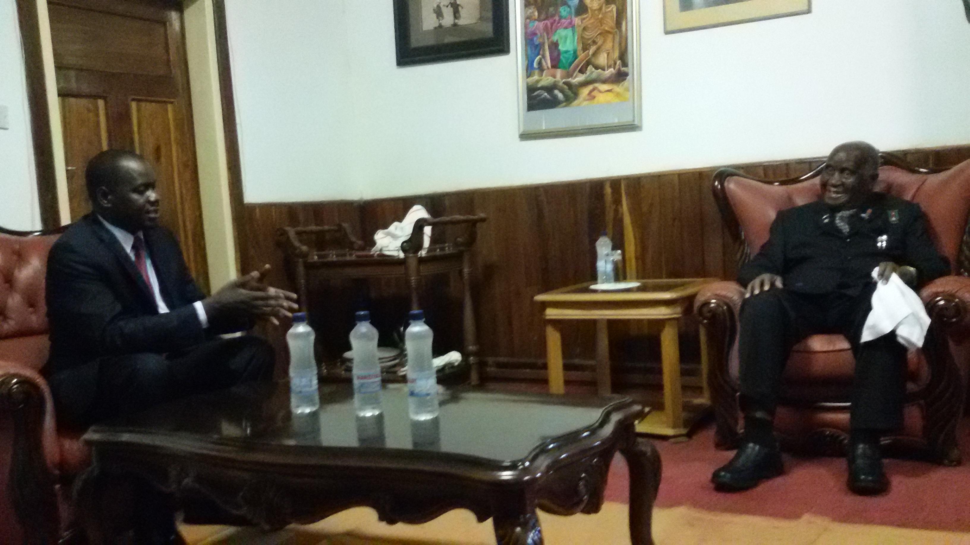 H.E. Dr Kenneth Kaunda receives a brief from the EALA Speaker, Rt Hon Daniel Fred Kidega