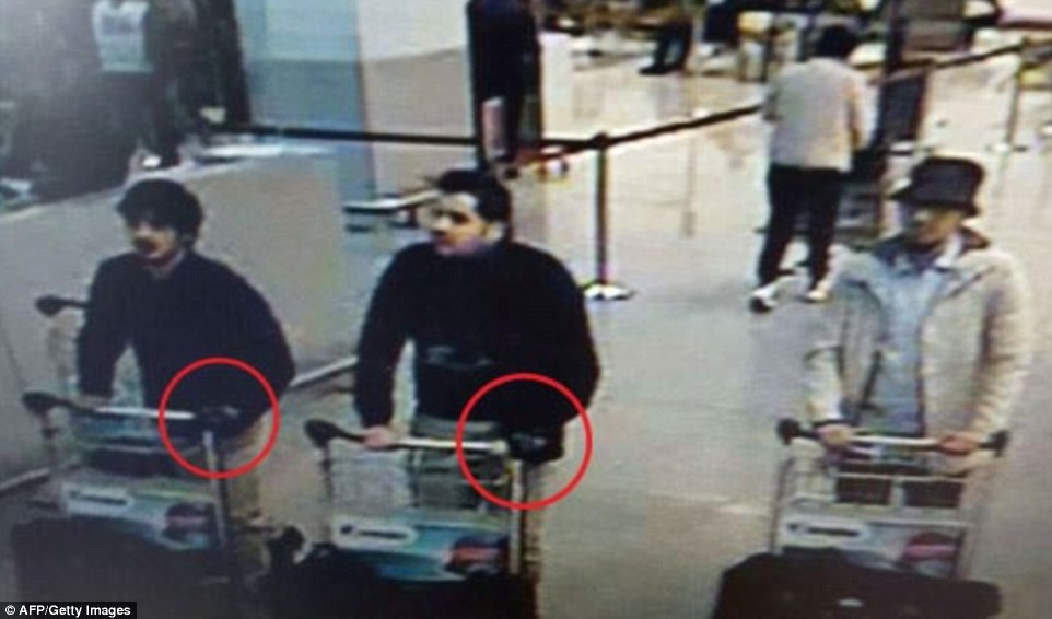 First picture: Belgian brothers Ibrahim and Khalid El Bakraoui, left, have been named by the Belgian media as the two airport suicide bombers - their accomplice in white remains at large having walked out of the airport