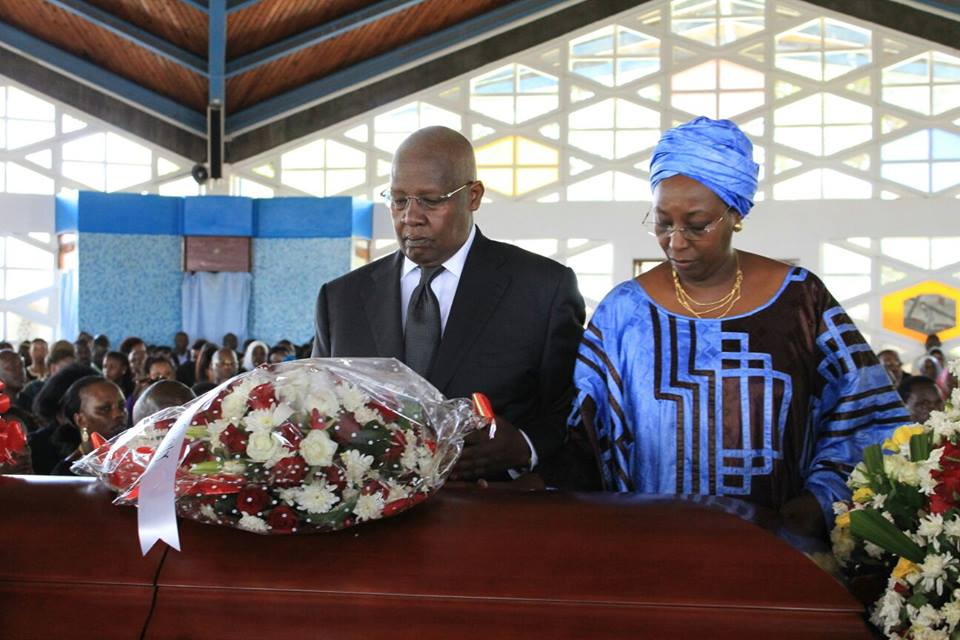 Foreign Affairs Minister Sam Kutesa and his wife lay a wreath
