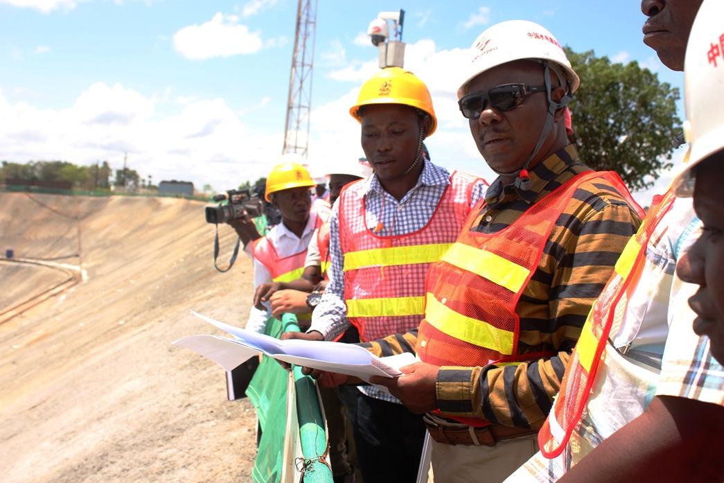 Energy Permanent Secretary Dr. Kabagambe Kaliisa (L) being briefed at Karuma HPP
