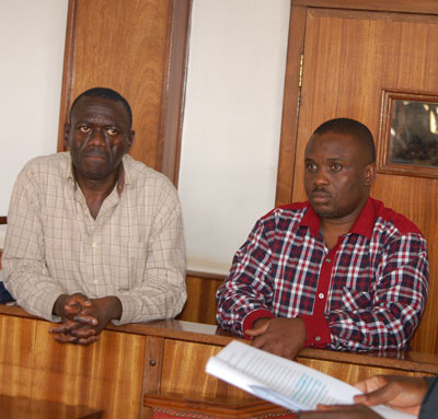 Kizza Besigye (L) and Erias Lukwago in court earlier