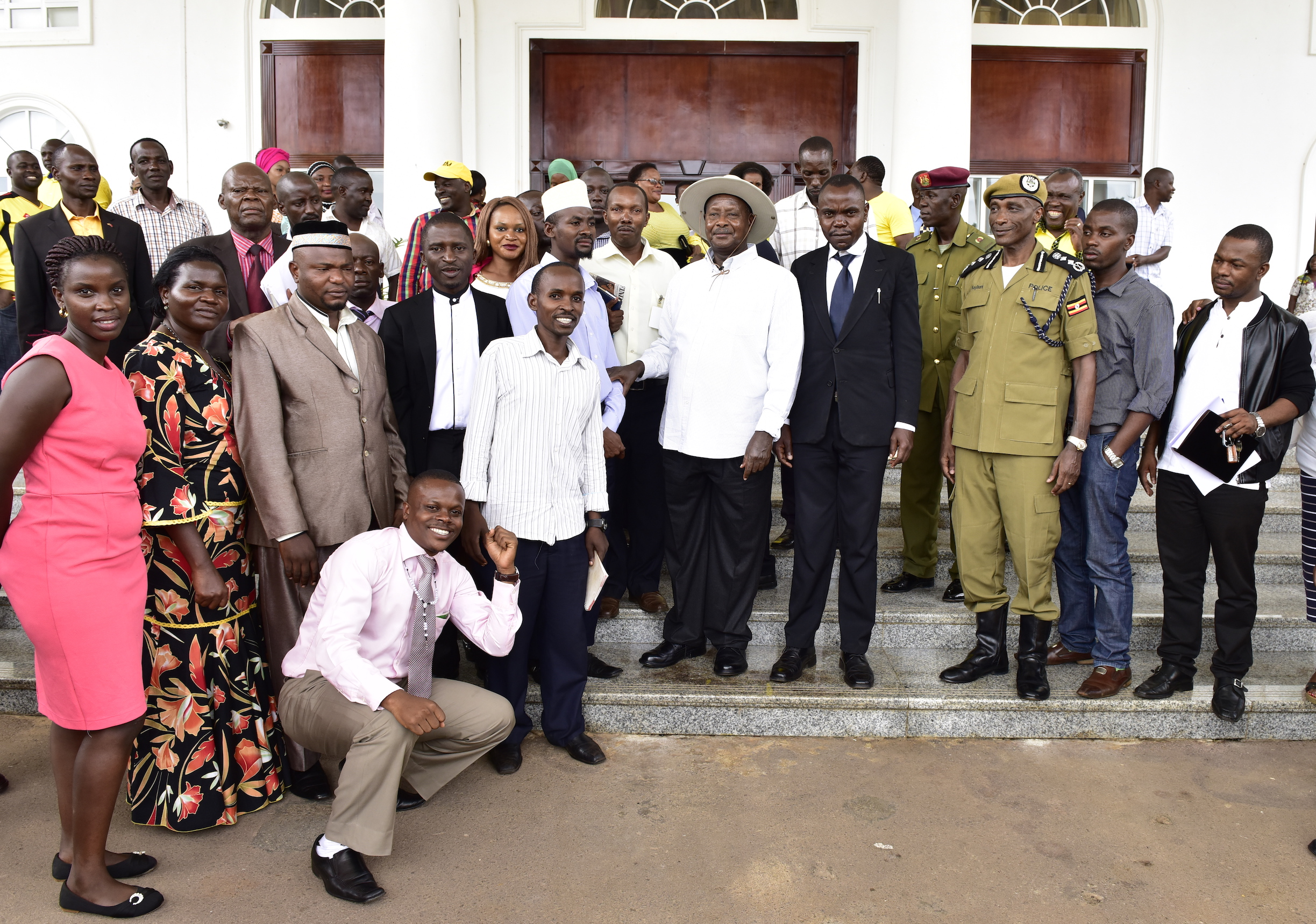 President Yoweri Museveni posses for a photo with a group of KCCA Councilors from the five divisions of Kampala who met him at State House Entebbe yesterday April 24. PPU Photo.