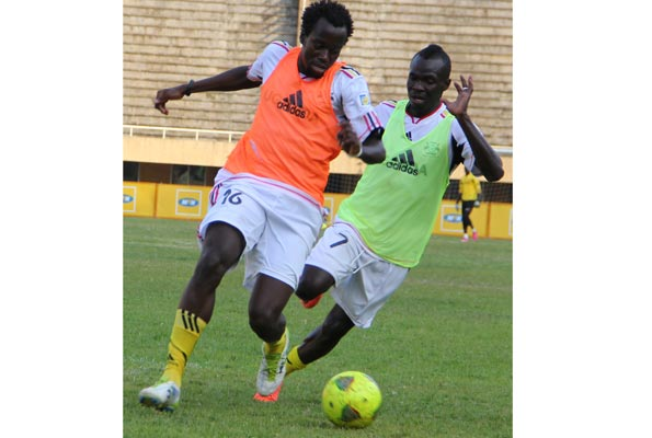 Centre back Savio Kabugo jostles for the ball with Emmanuel Okwi in a national team training session