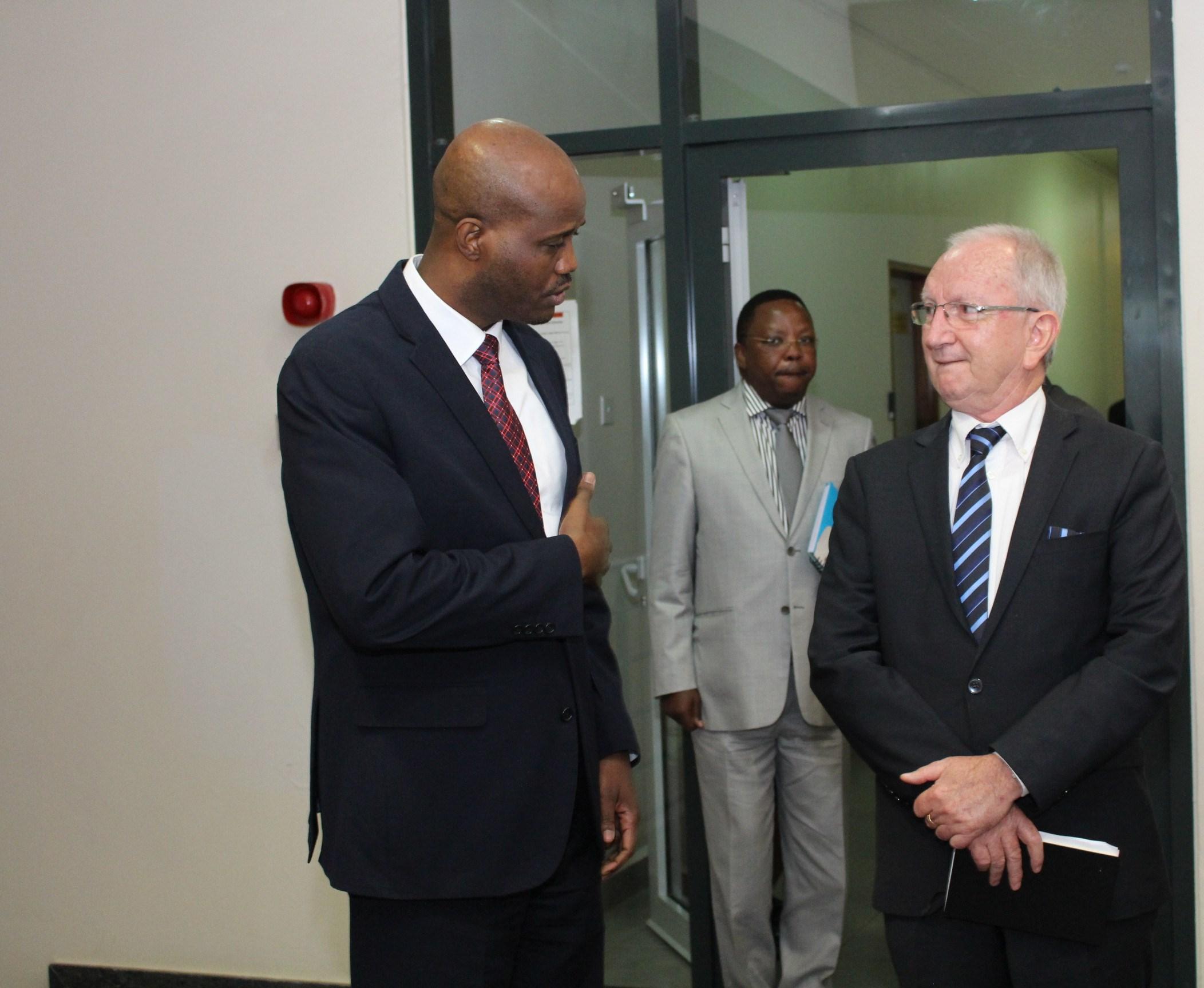 Belgium Envoy H.E.Paul Cartier having a chat with the EAC Secretary General Amb.  Mfumukeko