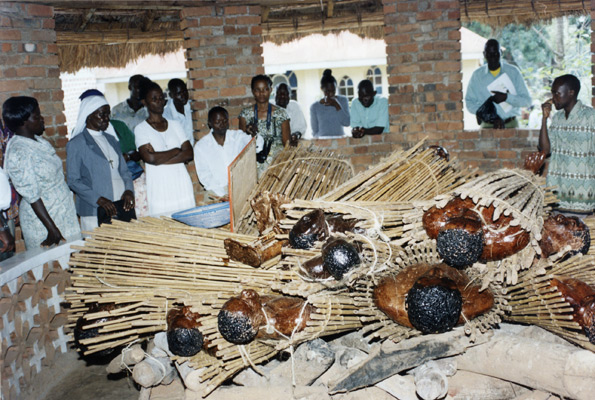 Pilgrims looking at effigies of some of the Uganda martyrs who were burnt alive