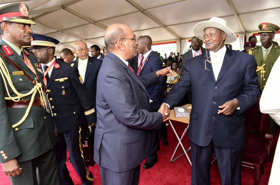 DEFIED INTERNATIONAL JUSTICE: President Omar Al Bashir shakes hands with his host President Yoweri Museveni at the latter's swearing in in Kampala