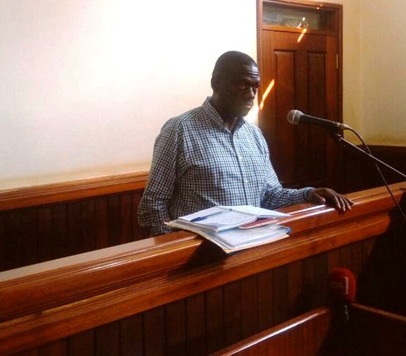 Dr Besigye in the dock at Nakawa Magistrates Court before Nakawa court Chief Magistrate James Mawanda Eremye on charges of treason.