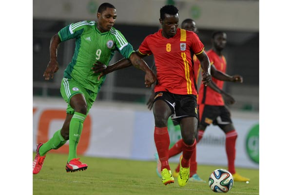 Khalid Aucho takes on a Super Eagles player during an international engagement