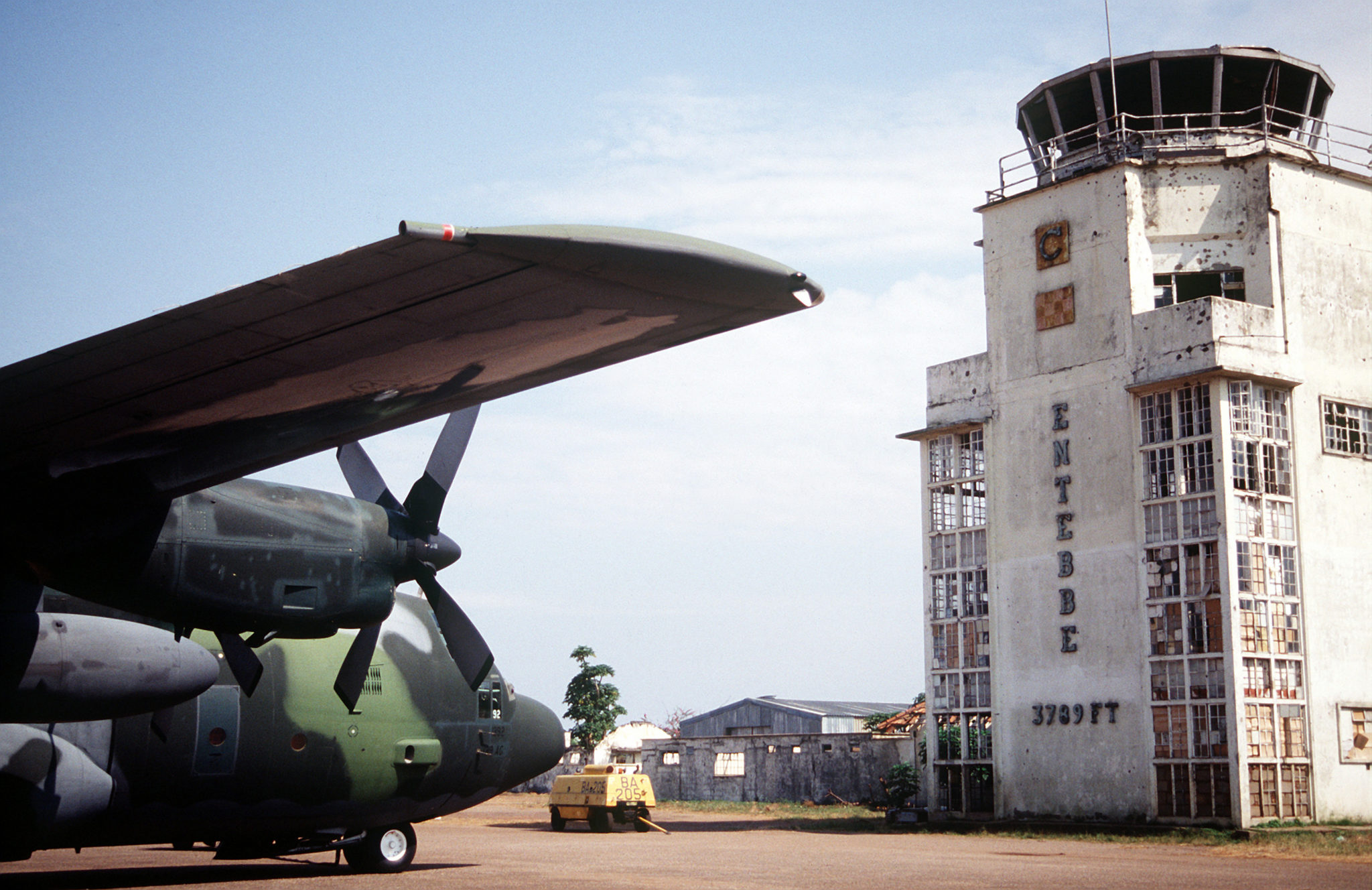 A C-130 Hercules in front of the old terminal in 1994. Bullet holes from the 1976 raid are still visible.