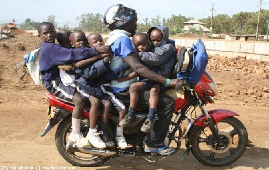 DANGEROUS LOADING: A motorcycle rider carrying six pre-primary school children. Photo/watsupuganda.com
