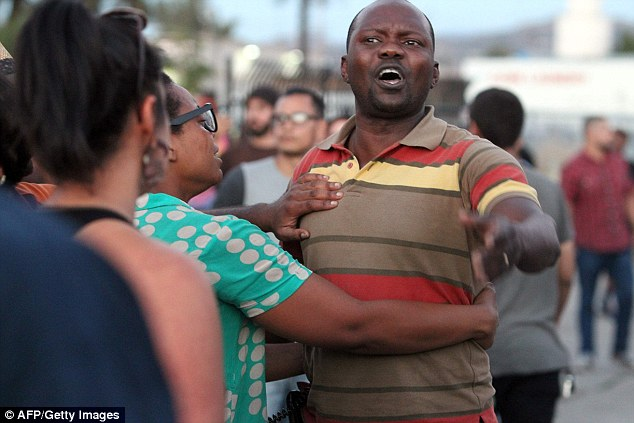 AGGRIEVED: A_man_claiming_to_be_Alfred_Olango_s_cousin_shouts_at_police_during the protests