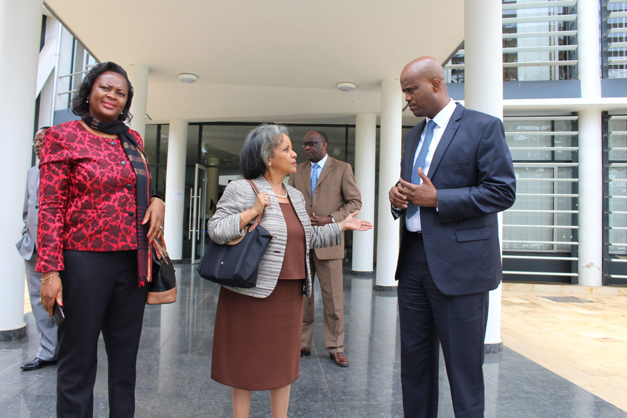 Director General of the UN Office in Nairobi, H.E. Sahle-Work Zewde, with EAC Secretary General Amb. Liberat Mfumukeko outside the EAC Headquarters. On the left is Ms. Ruphina Mbua Manono, the Political Adviser to the Director General.