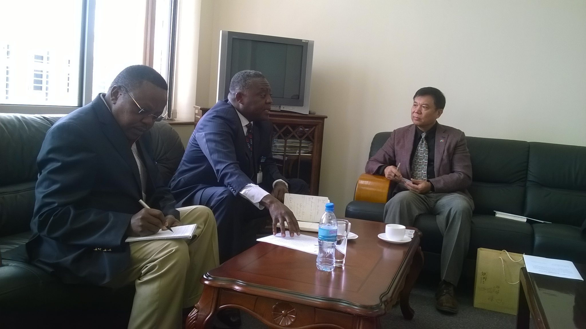 Mr. Gou Haodong, Minister-Counsellor at the Chinese Embassy in Dar es Salaam, with the Director of Infrastructure at the EAC Secretariat, Mr. Philip Wambugu. On the left is the Dr. James Njagu, the Chef de Cabinet to the EAC Secretary General.