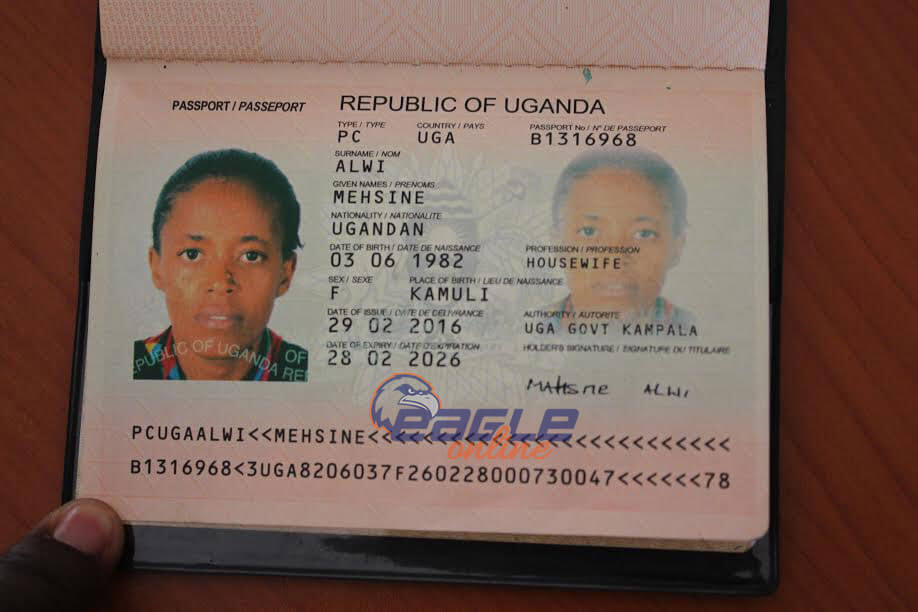 Ms Alwi's passport showing travel details to Tanzania.