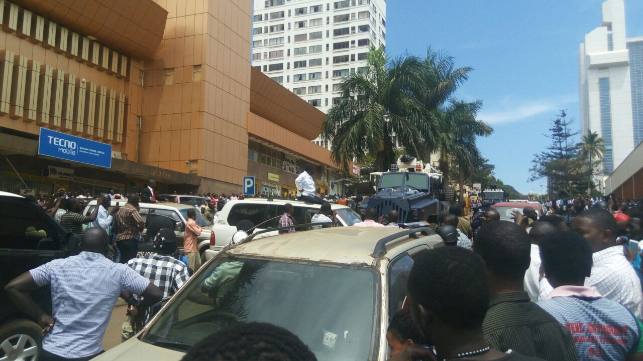 CROWDS: Dr Besigye draws crowds as he is driven thrugh the city centre
