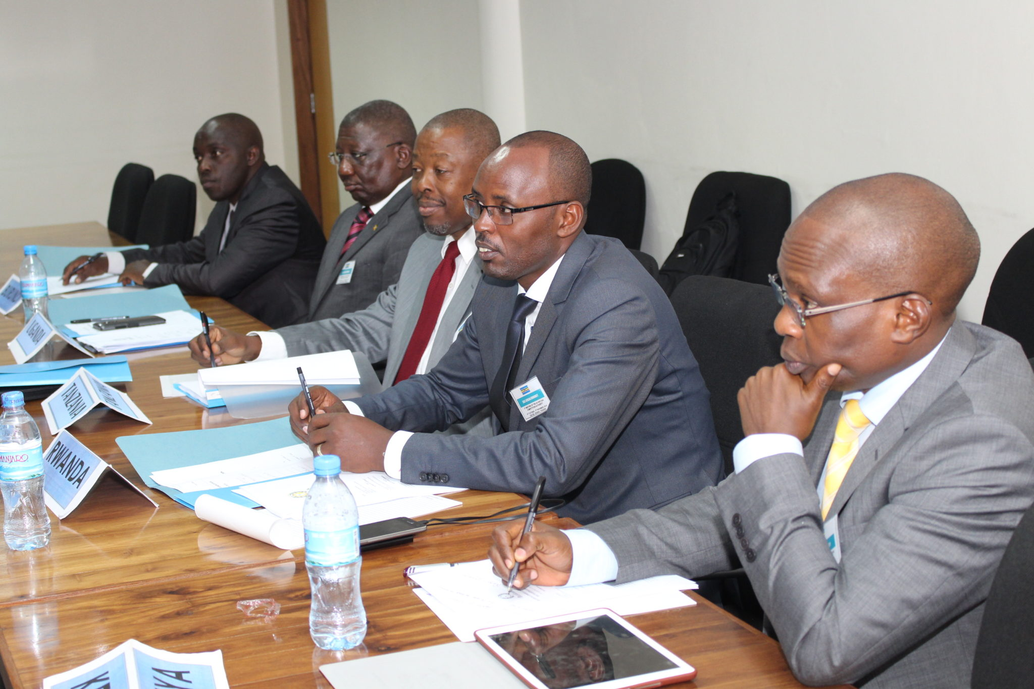 The five newly sworn in Commissioners of the EAC Competition Authority (L-R), Innocent Habarugira (Burundi), Mr. Sam Watasa (Uganda), Dr. Frederick Ringo (Tanzania), Dr. Didas Kayihura (Rwanda) and Francis Kariuki (Kenya), at the Commission's inaugural meeting held at the EAC Headquarters.