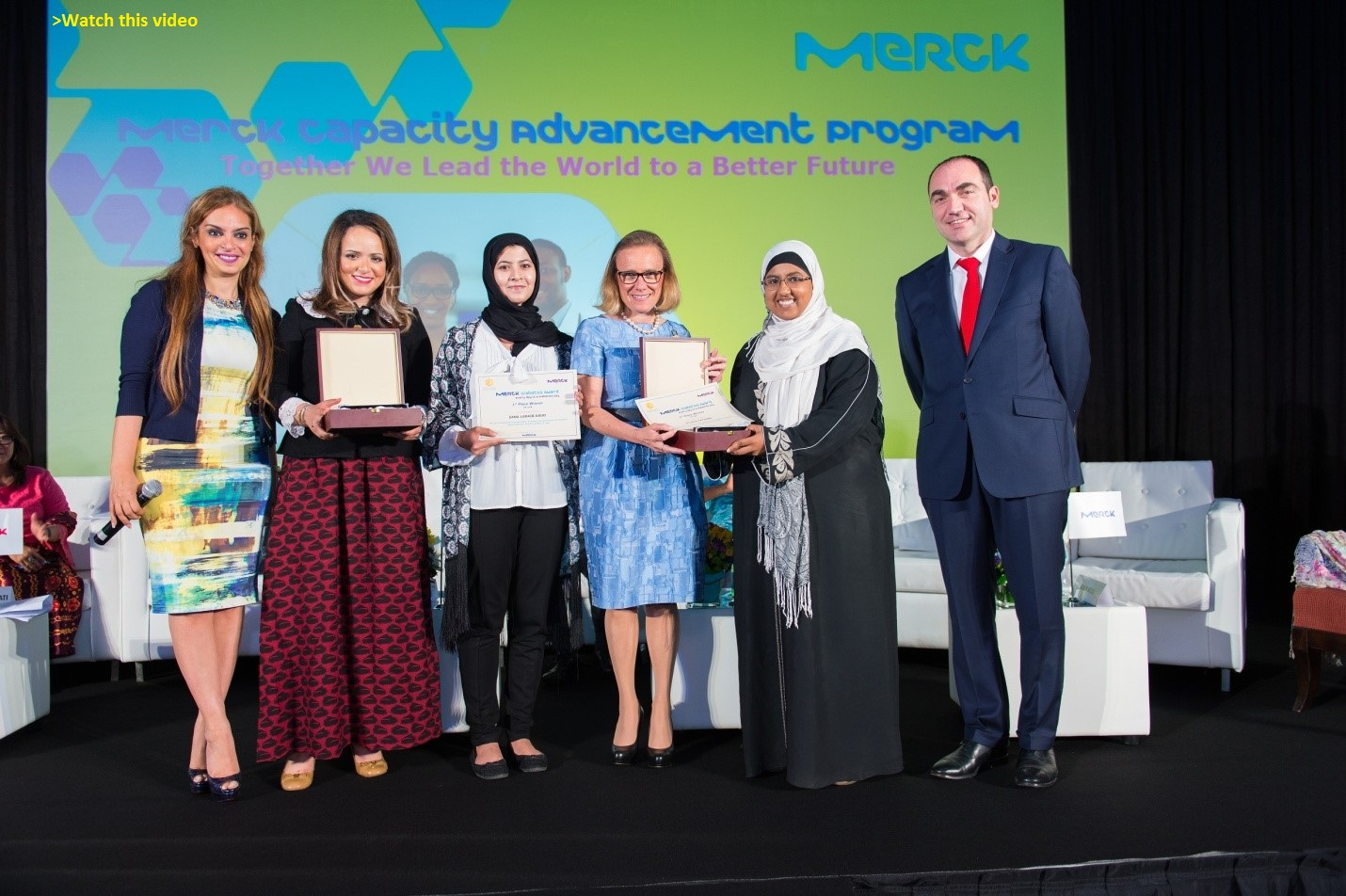 Sana Laraib Daud and Zoubia Fathima from United Arab Emirates receive their awards from Belen Garijo, CEO, Merck Healthcare.