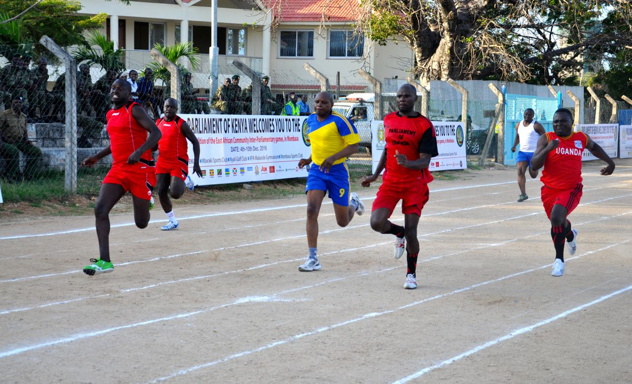 Senator Isaac Melly of Parliament of Kenya dashes to the finish line in the 400x1 Men finals. Kenya won that particular race.
