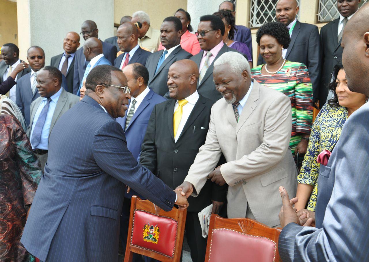 The Senate Speaker, Rt Hon Ekwee Ethuro shakes hands with EALA Member, Hon Taslima Twaha as other members look on.